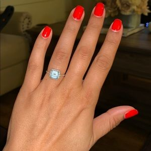 Aquamarine cushion cut ring with diamond halo